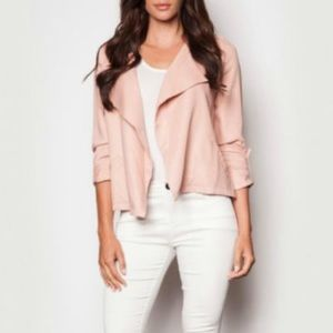 Blush coloured open front jacket.